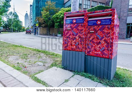 TORONTO - 1 July 2016: Two Canada Post mailboxes in Toronto, Canada.