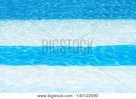 blue and white striped swimming pool background showing cool crystal sun drench water shot for copy space backgrounds texts blog posts the web and posters