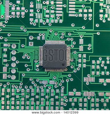 One chip on blank green electronic board (without dust)