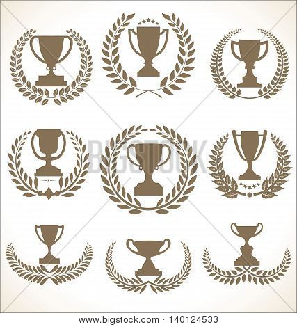 Award Cups And Trophy Icons With Laurel Wreaths  Colelction.eps