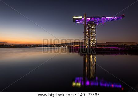 One of the few remaining Titan cranes remaining in Scotland reflecting in the River Clyde at Clydebank