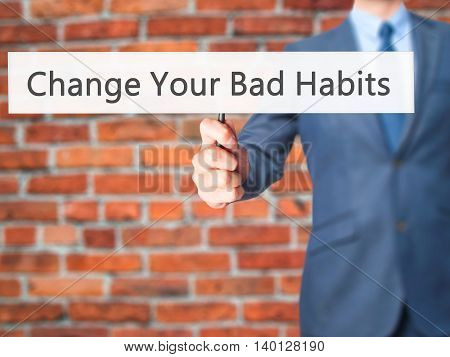 Change Your Bad Habits - Businessman Hand Holding Sign