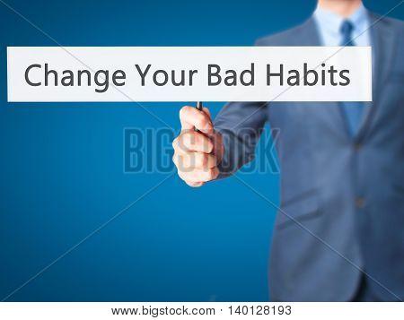 Change Your Bad Habits - Businessman Hand Holding Sign