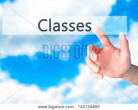 Classes - Hand Pressing A Button On Blurred Background Concept On Visual Screen.