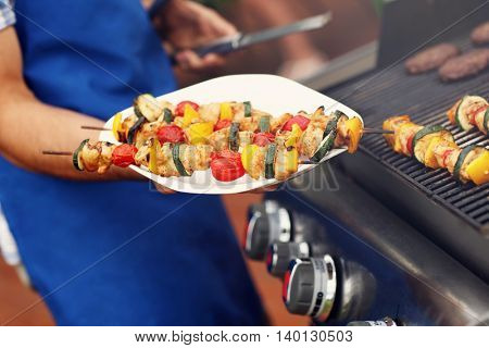 Closeup of grilled shashliks on plate