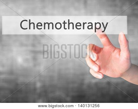 Chemotherapy - Hand Pressing A Button On Blurred Background Concept On Visual Screen.
