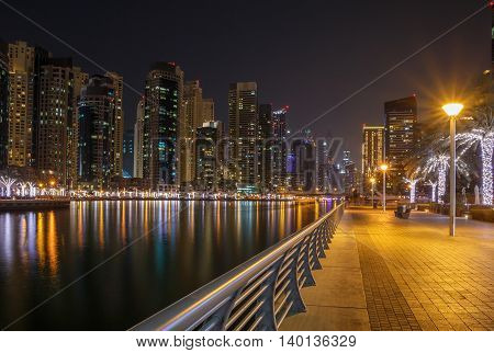 pedestrian walkway in district Marina at night