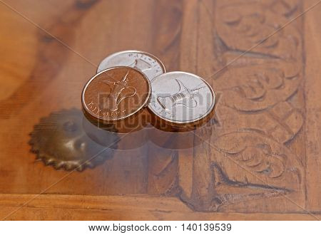 three dirham coins on old vintage table