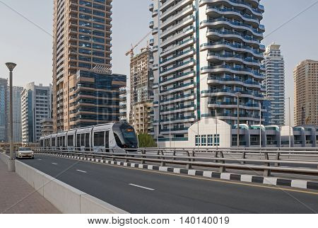 tram on bridge in district Marina in Dubai