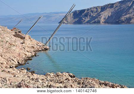 Adriatic rocky coast in Dalmatia. Mediterranean sea and rocky beach poster