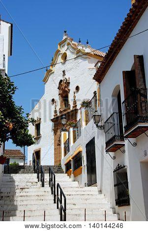 ESTEPONA, SPAIN - JULY 18, 2008 - View up a stepped street towards the church (Iglesia de Nuestra Senora del los remedios) Estepona Malaga Province Andalucia Spain Western Europe, July 18, 2008.