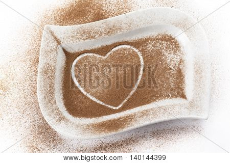 image of cocoa powder with heart shape trace