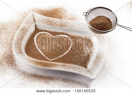 heath shape made of coffee beans isolated on white background