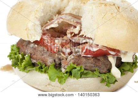 closeup ruined hamburger isolated on white background