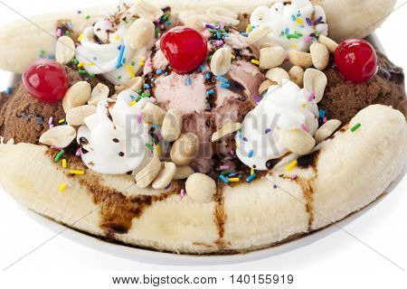 tempting banana split sundae isolated on a white background