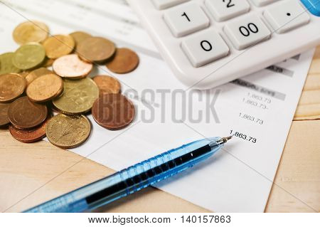 Pen and bill with calculator on wooden table, Money for income and expenditure saving for life and future vintage style