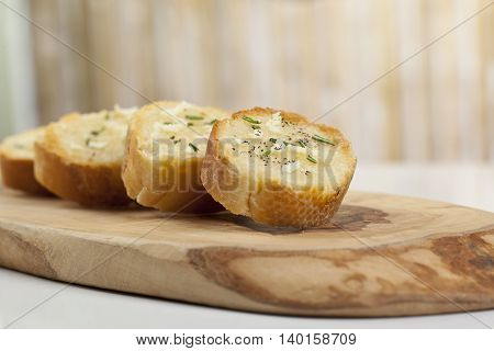 toasted baguette bread slices with garlic and pepper