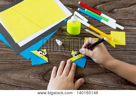 The Child Makes A Book With A Bookmark Mignon. The Child Draws The Details Of Paper Products. Glue,