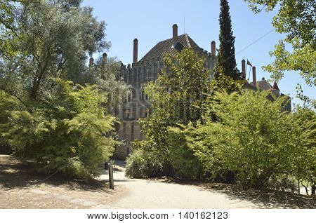GUIMARAES, PORTUGAL - AUGUST 9, 2015: Way among trees to the Palace of the Dukes of Braganza in Guimaraes in the northern region of Portugal.