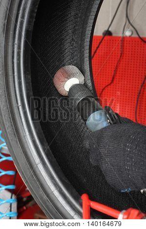 Car service: Tyre repair. The worker repair of tire - Vulcanization