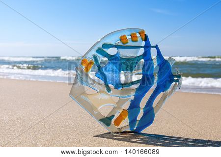 Abstract composition of colored glass in the background of the sea. Fusing