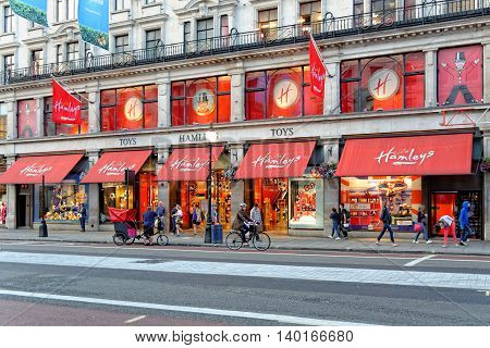 LONDON UK - JULY 1 2014: Hamleys Toy Shop on Regent Street in London in the evening. Founded in 1760 Hamleys is the oldest toy shop in the world.