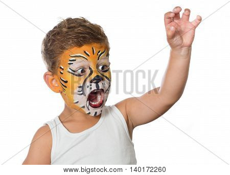 lovely boy child with painted face as a lion or tiger