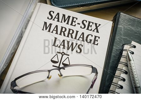 Same-sex marriage (Homosexual partnership) laws book. Homosexual rights concept.