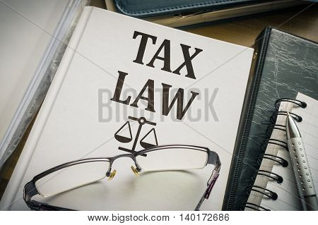 Tax Law Book. Legislation And Justice Concept.