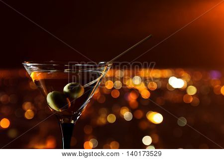 Martini With Olives On A Background Of Night City