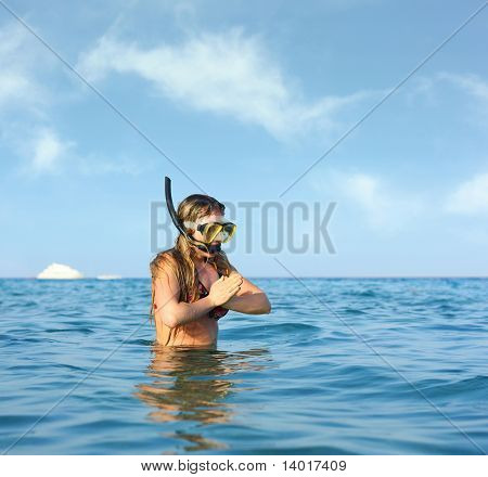 Young woman with diving mask going to jups in water