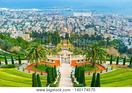 The ornamental Bahai Gardens landscaped down the Carmel Mount with the golden dome of the Shrine in the distance Haifa Israel.