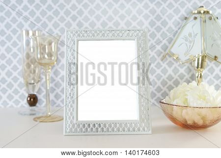 Blank vintage photo frame surrounded by antique amber  glassware