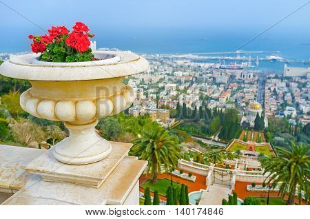 The cityscape of Haifa from the Carmel Mount with the ornamental Bahai Gardens and Mediterranean coast on the background Israel.