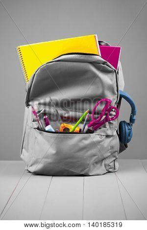 School rucksack on grey background