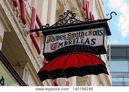 LONDON UK - JULY 1 2014: The famous James Smith and Sons Umbrella shop sign on New Oxford street. Founded in 1830 it is a stunning reminder of the Victorian period.