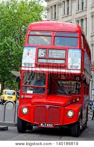 LONDON UK - JULY 1 2014: Red Routemaster Double Decker Bus in the City of London. These old double-decker buses are one of the most iconic symbols of London.