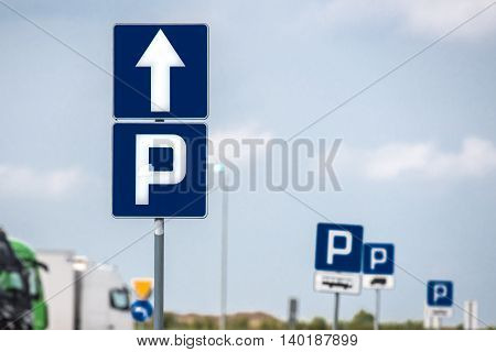 parking sign on the highway parking and trucks