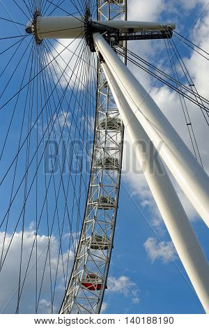 LONDON UNITED KINGDOM - JULY 1 2014: The London Eye - giant Ferris wheel on the South Bank of the River Thames. The entire structure is 135 metres tall and the wheel has a diameter of 120 metres.