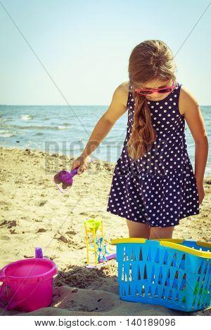 Little Girl Kid Child With Toy Having Fun On Beach