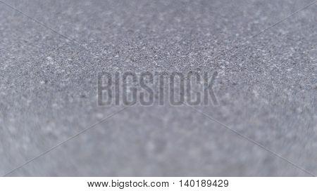 Selective focus grey textured background. Horizontal 16:9 format.