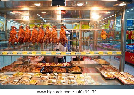 SHENZHEN, CHINA - CIRCA MAY, 2016: roasted duck at Walmart store. Wal-Mart Stores, Inc. is an American multinational retail corporation.