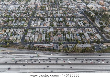 Los Angeles, California, USA - July 21, 2016:  After sunset aerial of the Santa Monica 10 Freeway and West Adams District community.