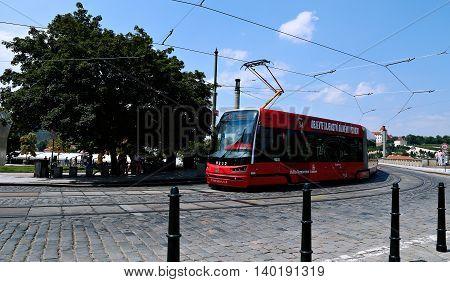 PRAGUE, CZECH REPUBLIC - JUNE 25, 2016: Red modern tram on street in Prague