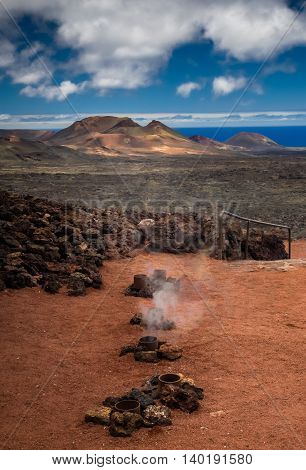 Hot water and steam vents in the Timanfaya National Park ( also called The Montanas del Fuego or Mountains of Fire ) in Lanzarote, Canary Islands, Spain
