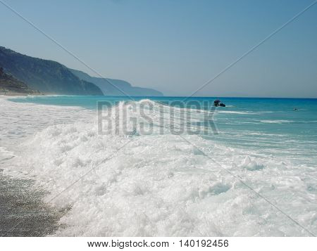 Wild Beach On Lefkada Island In Greece Water Crashing On The Rocks In The Background ach On Lefkada Island