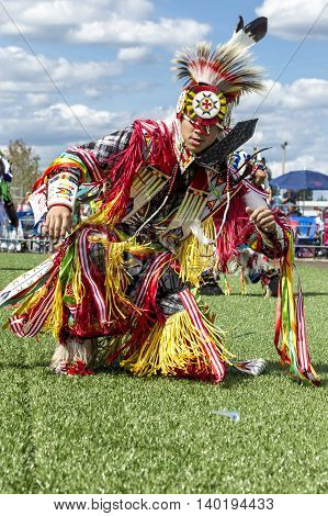 Coeur d'Alene Idaho USA - 07-23-2016. Tribal dance at powwow. Young dancer participates in the Julyamsh Powwow on July 23 2016 at the Kootenai County Fairgrounds in Coeur d'Alene Idaho.