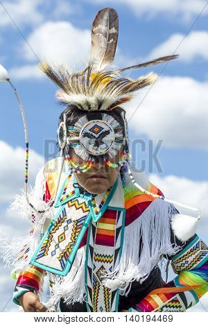 Coeur d'Alene Idaho USA - 07-23-2016. Close up of teen in native dress. Young dancer participates in the Julyamsh Powwow on July 23 2016 at the Kootenai County Fairgrounds in Coeur d'Alene Idaho.