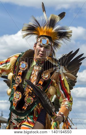 Coeur d'Alene Idaho USA - 07-23-2016. Native American man at ceremonial powwow. Young dancer participates in the Julyamsh Powwow on July 23 2016 at the Kootenai County Fairgrounds in Coeur d'Alene Idaho.