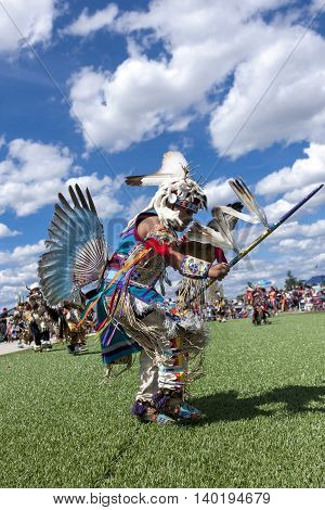 Coeur d'Alene Idaho USA - 07-23-2016. Ceremonial dance at Julyamsh powwow. Young dancer participates in the Julyamsh Powwow on July 23 2016 at the Kootenai County Fairgrounds in Coeur d'Alene Idaho.